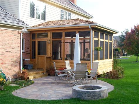 screen porch and patio with fire pit in hawthorn woods il