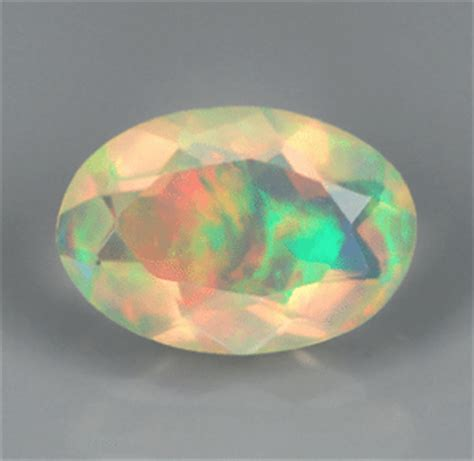 6 97 Ct Beautiful Colour Play Opal 0 29 ct multicolor opal oval faceted cut