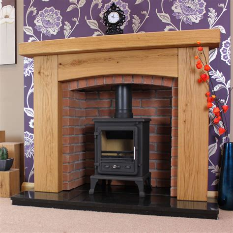 Oak Beam For Fireplace by Oak Surrounds Arched Rustic Oak Surround