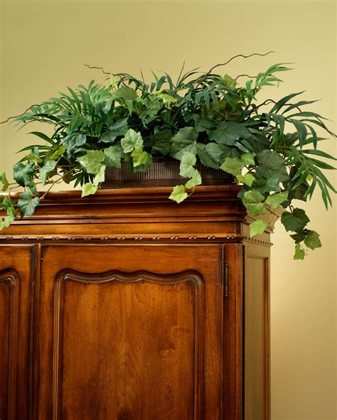 decorating ideas for top of armoire palm ivy armoire silk foliage planter for shelf and