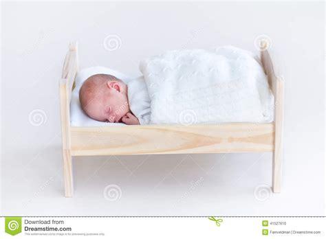 Newborn Sleep Crib by Tiny Newborn Baby Sleeping In A Crib Stock Photo