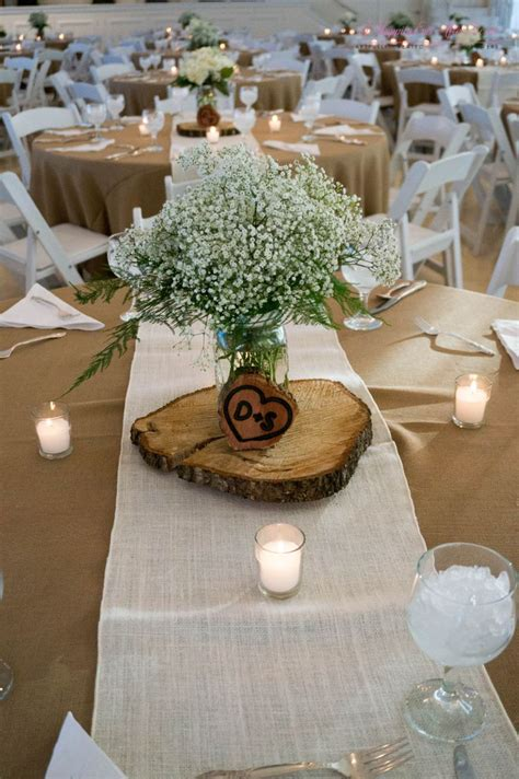 Wood Vases For Centerpieces by Babies Breath Centerpiece Sitting On Top Of Wooden Disk