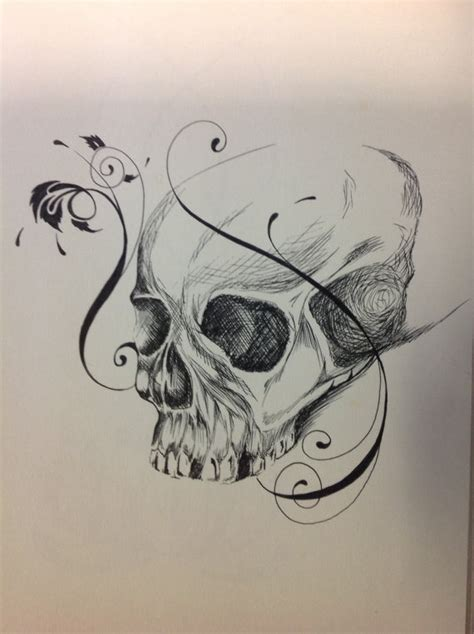 pen and ink skull and filigree drawing