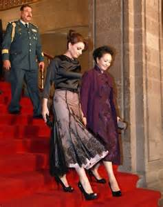 China s first lady added to vanity fair s international best dressed