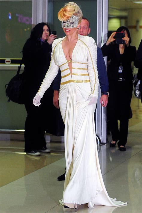 arriving in style lady gaga chose a vintage cadillac to take her to celebrity airport style fashion outfits looks glamour