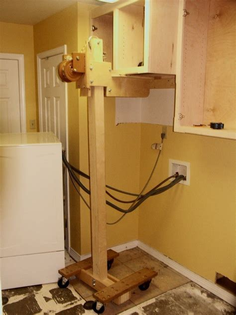 Kitchen Cabinet Lift Cabinet Lift By Kerry Fullington Cabinet Lift Constructed From Lumber Wheels And A