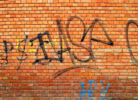 brick wallpaper with graffiti graffiti brick wall texture jpg onlygfx com