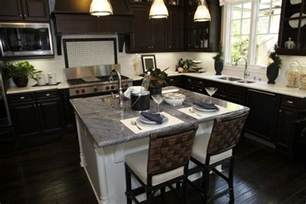 34 kitchens with dark wood floors pictures dark wood cabinets with a blue kitchen island omega