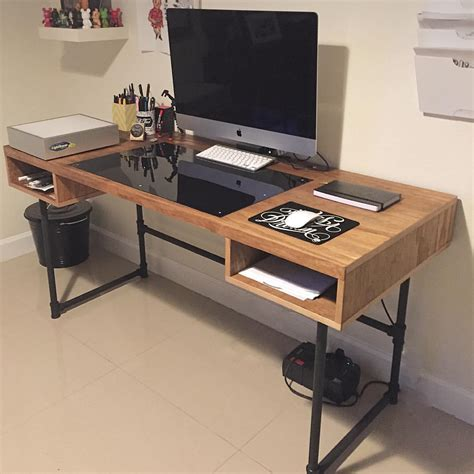 design a desk industrial design desk with steel pipe legs and an embedded plexiglass for the ideal drawing