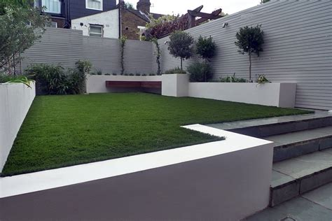 artificial grass planting white painted fences raised beds