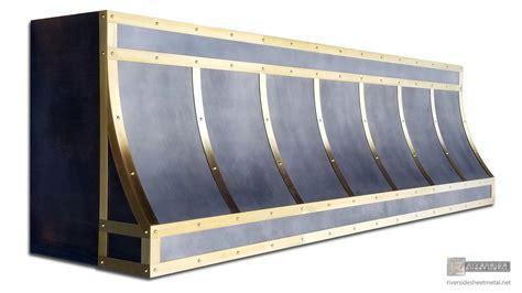 Types Of Backsplashes For Kitchen zinc range hood with brushed brass bandings and dark patina