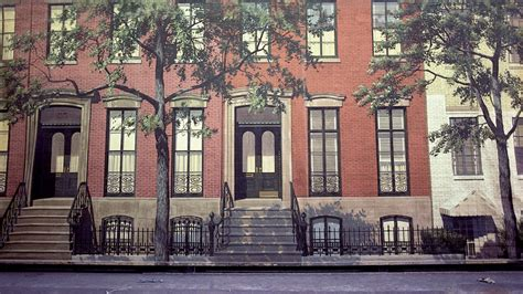 stock photo classic brick apartment building with styled iron fences with