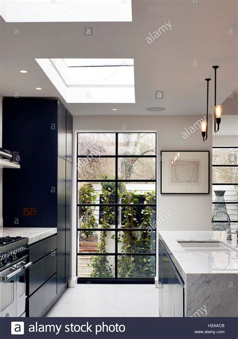 rounded kitchen skylights white cabinet yellow countertop
