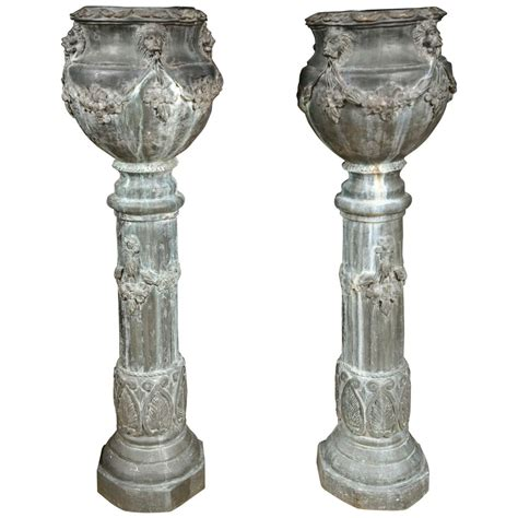 Column Planters pair of zinc column planters at 1stdibs