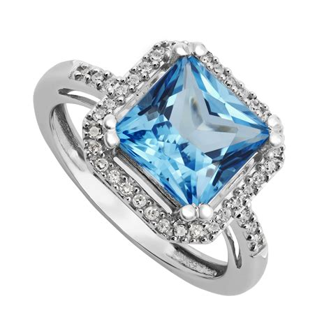 A595 Blue Topaz 6 9 Ct 9ct white gold cushion cut blue topaz and ring