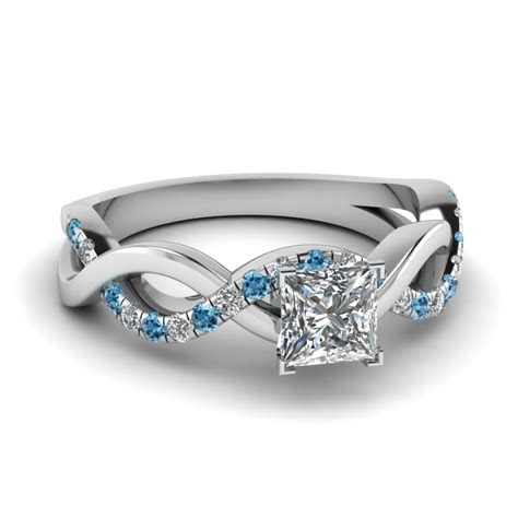 princess cut infinity ring with blue topaz in 14k
