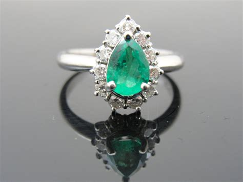 emerald engagement ring with halo onewed