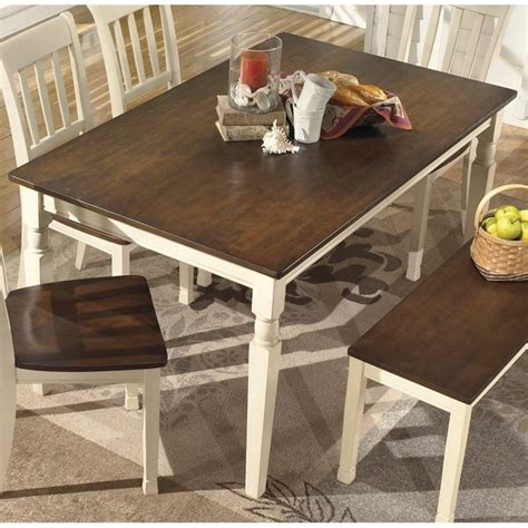 whitesburg rectangular dining table in brown and