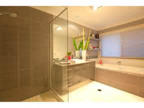 bath room design modern bathroom design with corner bath using tiles bathroom photo 464609