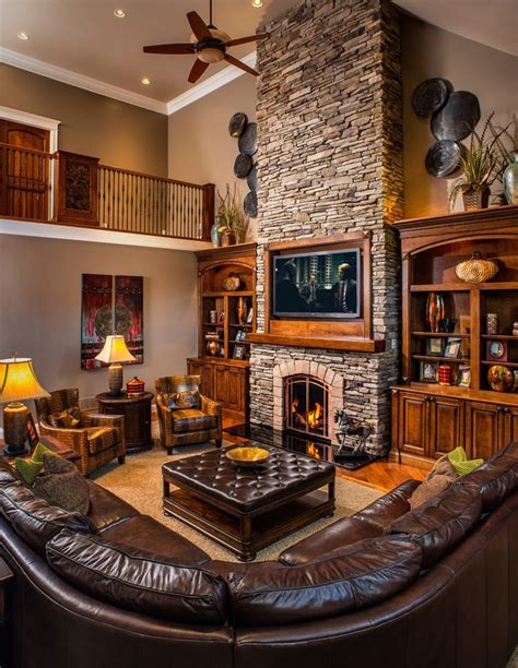 Native American Home Decorating Ideas two story stone fireplace living room rustic with built in
