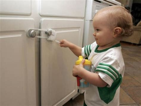 kitchen cabinet child locks how to babyproof your home yellowbrick me