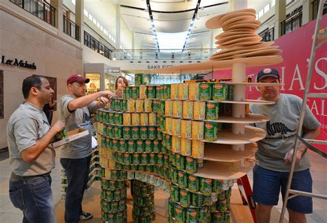 How To Build A Canned Food Sculpture by Students Help Firm Build Canned Food Dinosaur Sculpture