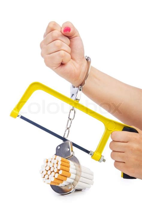 Detox From Ecigs by Addiction Concept With Cigarettes And Handcuffs Stock