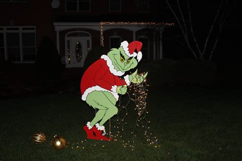 grinch stealing christmas lights yard art grinch yard art