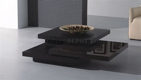 dark brown contemporary coffee table  rotating table panels