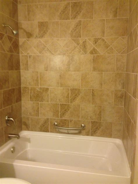 beige bathtub beige tile tub surround with diamond border pattern tiled