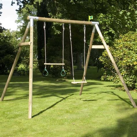 swing sets uk tp knightswood double wooden swing set with wooden trapeze
