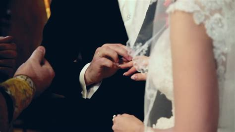 stock video clip of bride and groom exchanging wedding