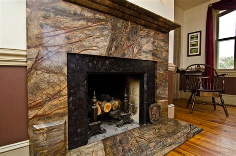 Rainforest green granite amp leathered antique brown granite fireplace