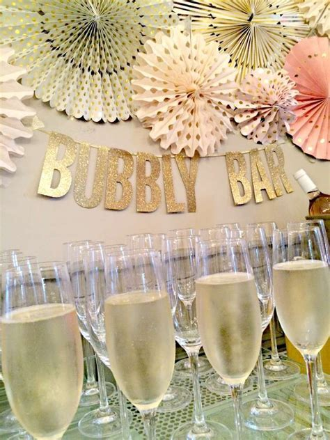 Bubbly bar at a pink and gold bridal shower party! See