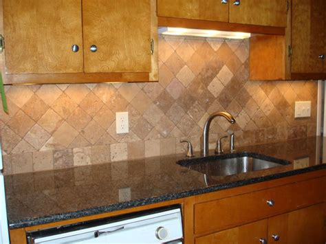 travertine backsplash with accent