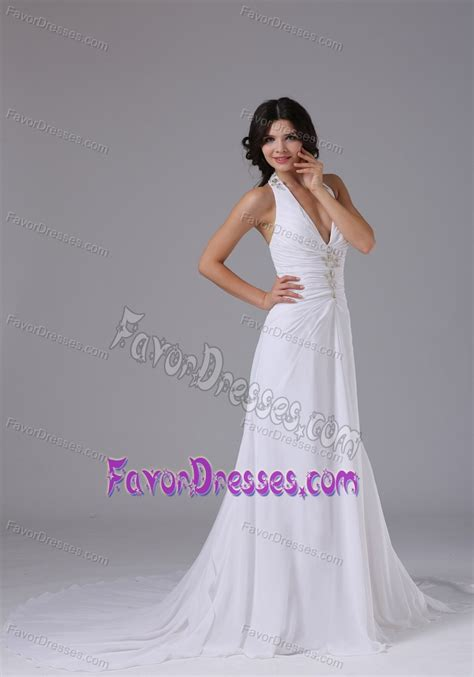 halter wedding dress with ruched bodice and beading on