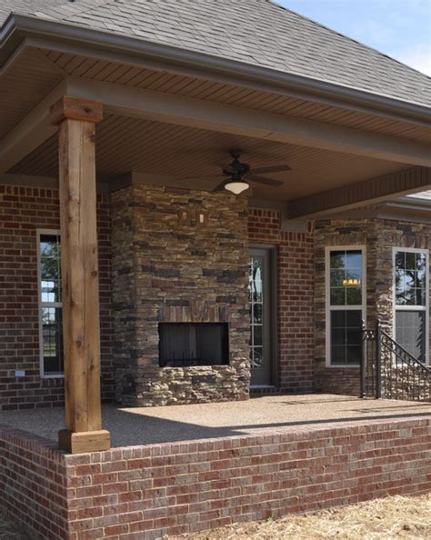 exterior stone fireplace and cedar posts contemporary