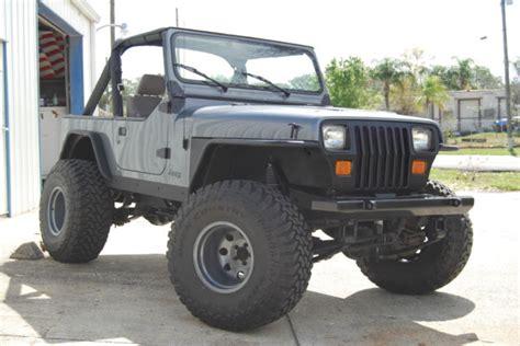 jeep grey jeep yj wrangler 4x4 4 2l inline 6 cylinder grey black
