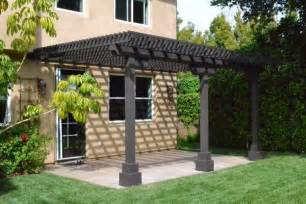 This home has two pergola style wood patio covers painted white