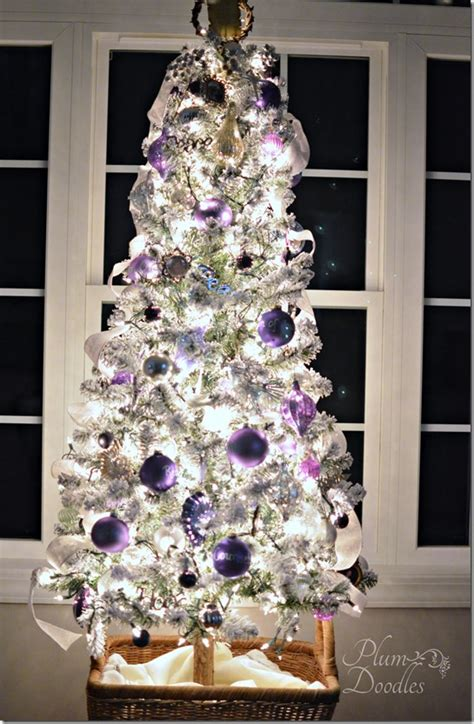 a purple white and silver themed christmas tree plum
