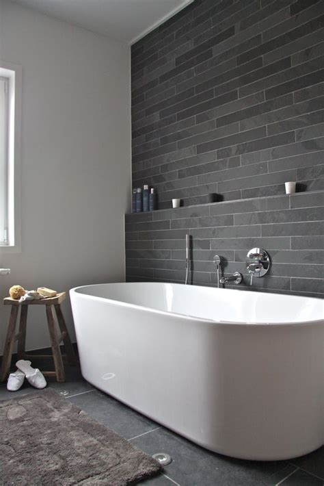 feature wall bathroom ideas square freestanding bath dark gray tile bathroom bathroom