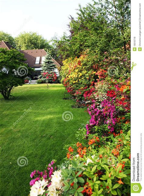 house  flower garden stock photo image  meadow