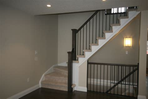 open staircase to basement allowing light into the basement i like the open idea for