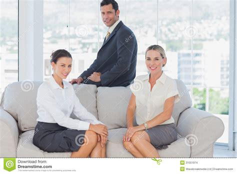 people having on the couch business people sitting on the couch stock images image