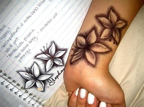 tattoo flower piercing lilly tattoo this would be cool for the ear tattoo