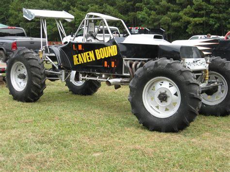 monster trucks racing in mud mud bogging 4x4 offroad race racing monster truck race