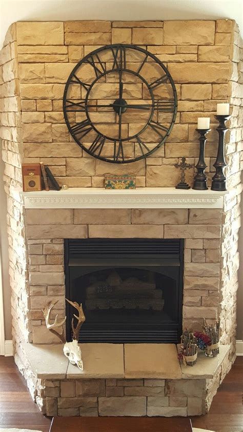 stone fireplace  clock fireplace mantel decor
