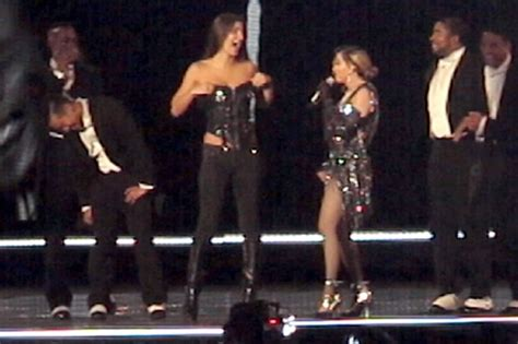 Pulls A Madonna by Madonna Fan Whose Breast Was Exposed Onstage In Australia