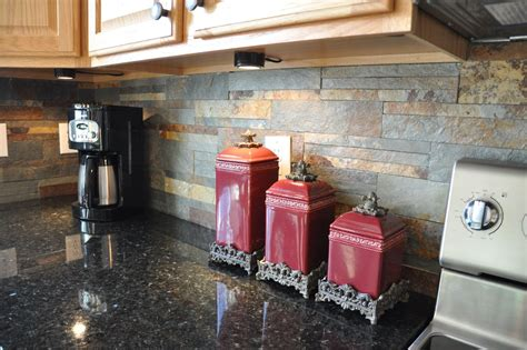 uba tuba granite countertops kitchen eclectic with