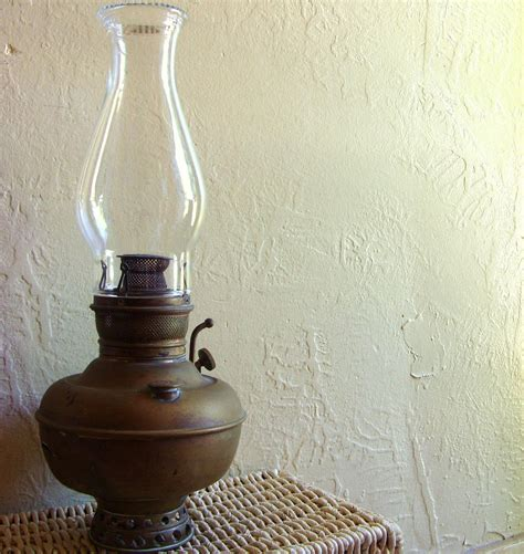antique juno brass oil lamp with glass globe in by shabbynchic